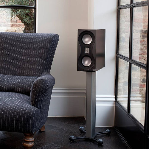 Monitor Audio speakers on a stand in the corner of the living room